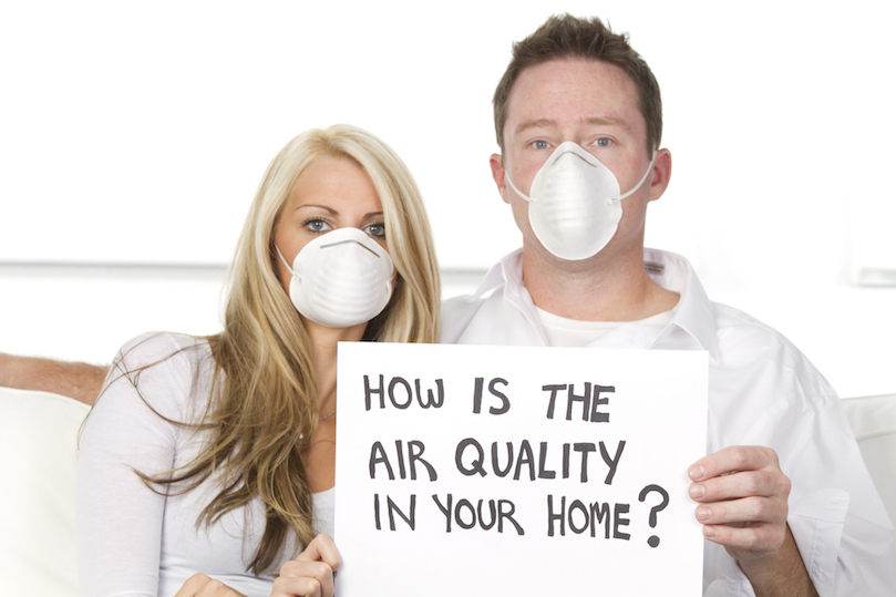 Couple wear masks to protect against dirty air in home